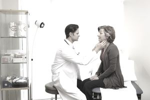 Male doctor examining female patient