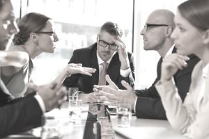 Group of five businessmen in disagreement