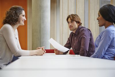 A woman at job interview with two hiring managers