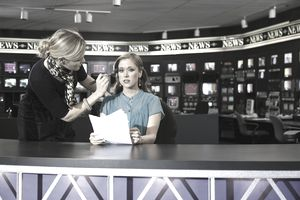 Female newscaster getting primped