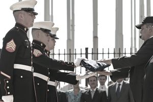 Marines handing over folded flag