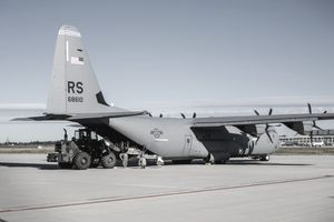 A U.S. Air Force C-130J Super Hercules is being unloaded.