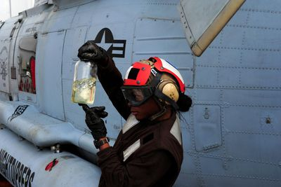 ATLANTIC OCEAN (June 28, 2011) Aviation Structural Mechanic Airman Kyndall Bennett checks the fuel from an HH-60H Sea Hawk helicopter assigned to the Nightdippers of Helicopter Anti-Submarine Squadron (HS) 5 for contaminates aboard the aircraft carrier USS Dwight D. Eisenhower (CVN 69). Dwight D. Eisenhower is conducting carrier qualifications and flight deck certifications.