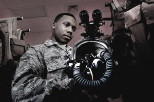 Staff Sgt. Shamir Moore, 58th Rescue Squadron aircrew flight equipment technician, tightens a parachute cord before repacking a MC1-1D parachute June 24, 2013, at Nellis Air Force Base, Nev. Airmen inspect each parachute to ensure there are no frayed cords or rips in the canopy.
