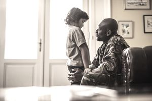military dad talking to child during military family separation