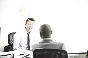 Smiling businessman in discussion