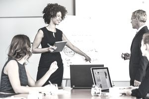 Female Businesswoman Giving Presentation to Colleagues