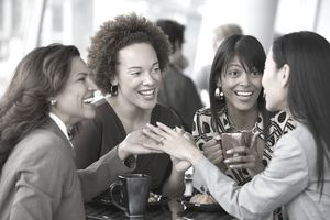 Multi-ethnic businesswomen chatting during a work coffee break