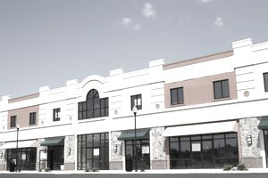 Store front view of a block of new commercial spaces for lease