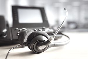 Headset headphones and telephone in police dispatcher call center