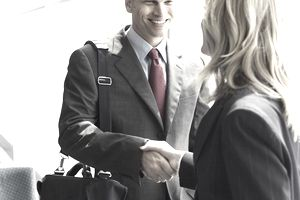 Man shaking hands with woman, accepting a job offer