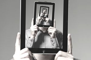 A photo of a man's face repeating itself on a tablet screen