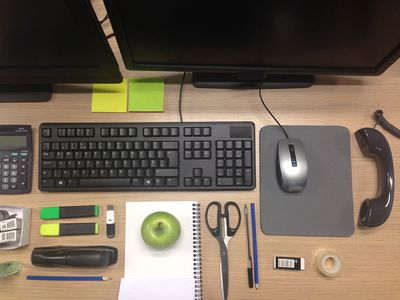 Overhead view of an organized office work space