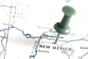 A pin stuck in a map of New Mexico