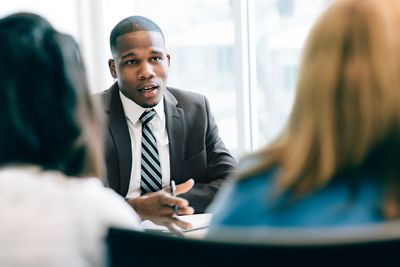 Two women at a meeting with a financial advisor