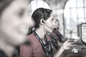 Row of female telephonists working in call centre