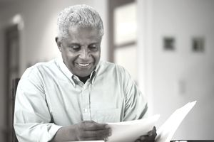 happy man reading a letter