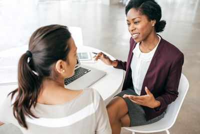 Two women at a business meeting.