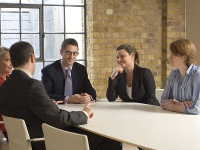 Businessman leading a meeting in a conference room.
