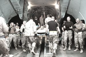 Airmen applaud and cheer, thanking wounded Soldiers and Marines for their service in the fight against Al Qaeda in Iraq as they are brought aboard the last C-141 Starlifter combat-zone aeromedical evacuation flight Sept. 29, 2005.