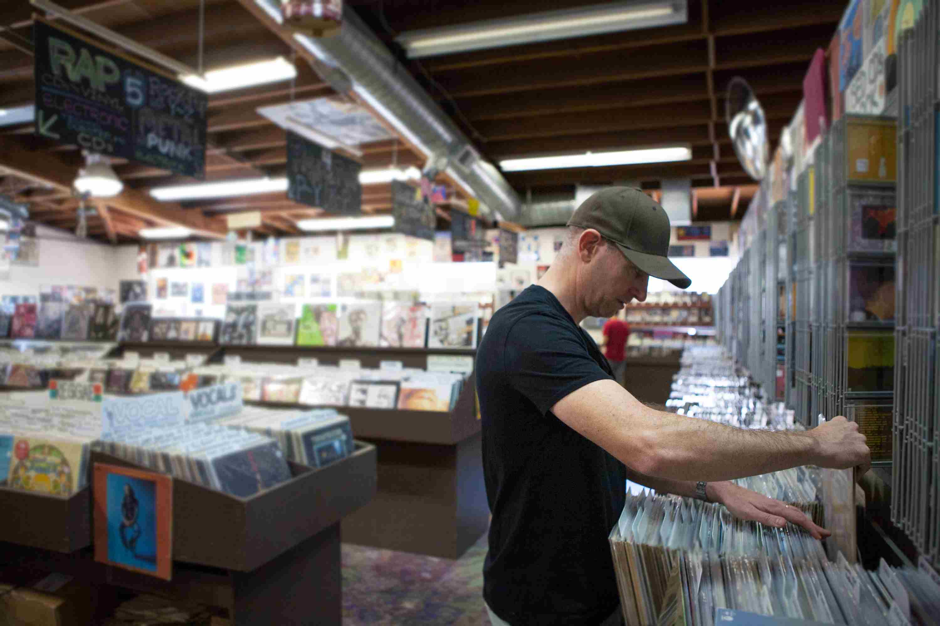Man in record store looking through vinyl albums