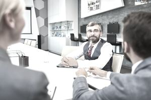 Mature Businessman in Meeting