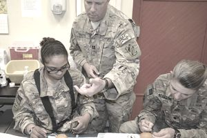 U.S. Army Captain Walter Mathis, the 3rd Sustainment Brigade's physician assistant, suture training