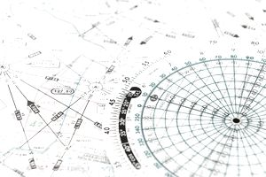 Close-up of a flight chart and computer - stock photo