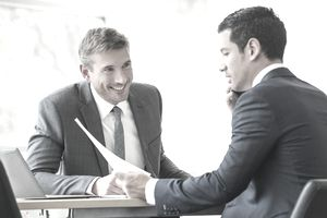 Two accountants at a desk working for one of Vault's top accounting firms.