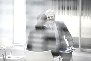 Smiling businessman talking to businesswoman