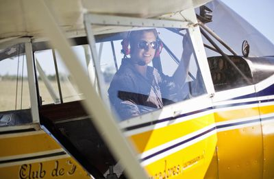 young pilot in propeller driven plane