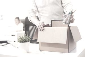 Dismissed worker packing office supplies