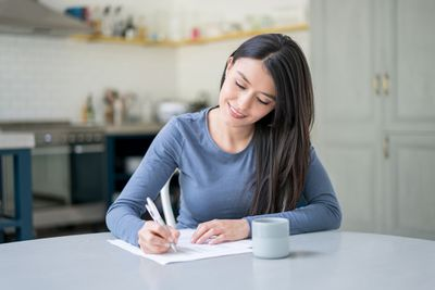 Woman signing letter