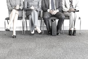 Business people waiting in chairs