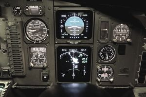 Cockpit Display Showing the Map Display That Depicts Terrain Ahead, Airspeed, Attitude Indicator, and Altimeter