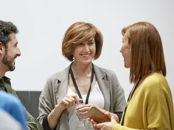 Female and male professionals at convention center
