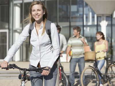 College students with bicycles on campus