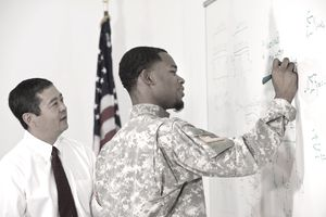 Army student working on problem in the classroom