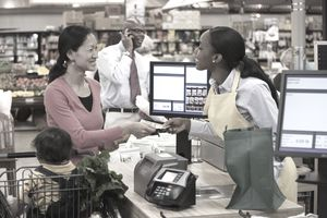 Cashier helping a customer in a super market