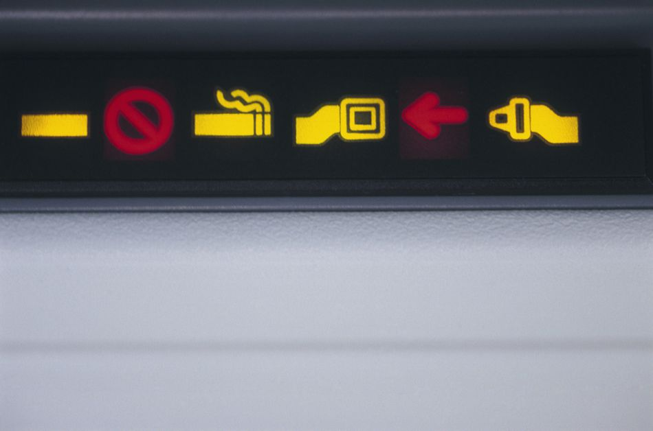 Illuminated seatbelt Signs on Airplane during a general aviation passenger briefing