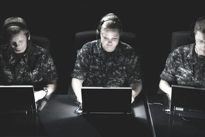 Soldiers Sitting in Front of Laptops