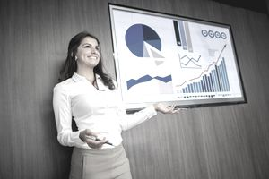 Confident-looking business woman presenting to a group.