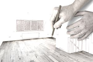 Two hands Drawing a Modern renovated interior