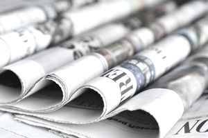 Close-up of rolled up newspapers