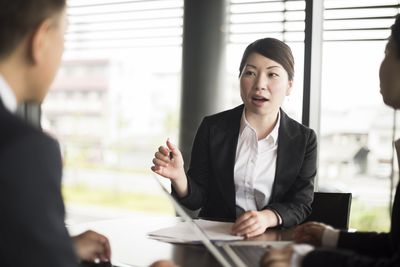 Woman gesturing during job interview