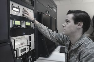 U.S. Air Force Senior Airman Daniel Ullery, 488th Intelligence Squadron multimode systems operator from Eva, Ala., operates a ground data processing system Dec. 6, 2013