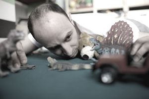 Man Playing With Toys