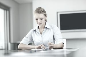 Business woman working on plans at a conference room