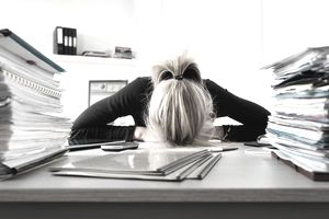 Businesswoman resting head on desk