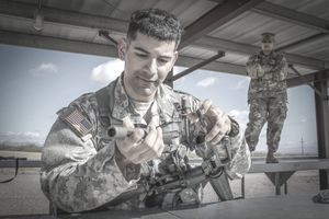 "Army Reserve Sgt. Alexandro Magana, a cable systems installer/maintainer and native of Redding, Pennsylvania, assigned to Company B, 392nd Expeditionary Signal Battalion, 335th Signal Command (Theater) assembles a M16A2 rifle during a ""Mystery Event""."